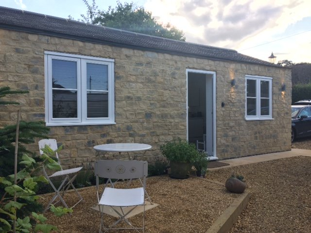 Raised outside private seating area with garden views. Parking to front.