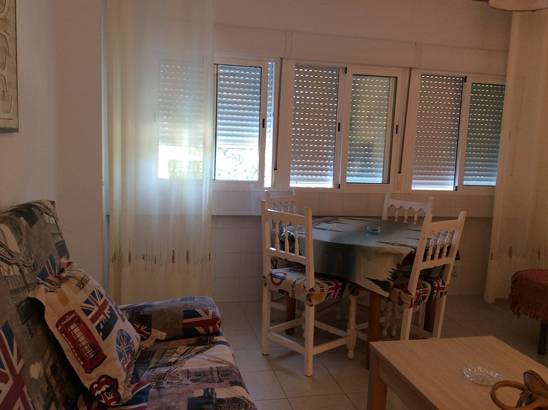 Apartment in manga del mar menor km1, a room with sofa bed.