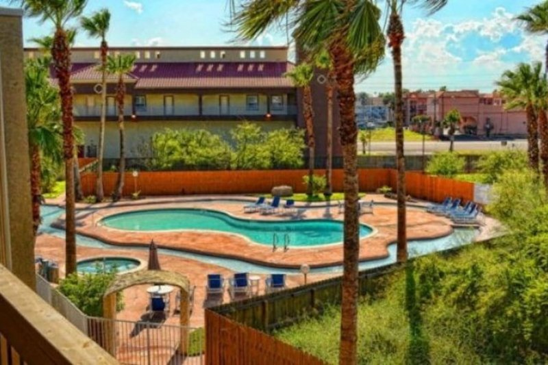 View of lazy river pool and spa from balcony