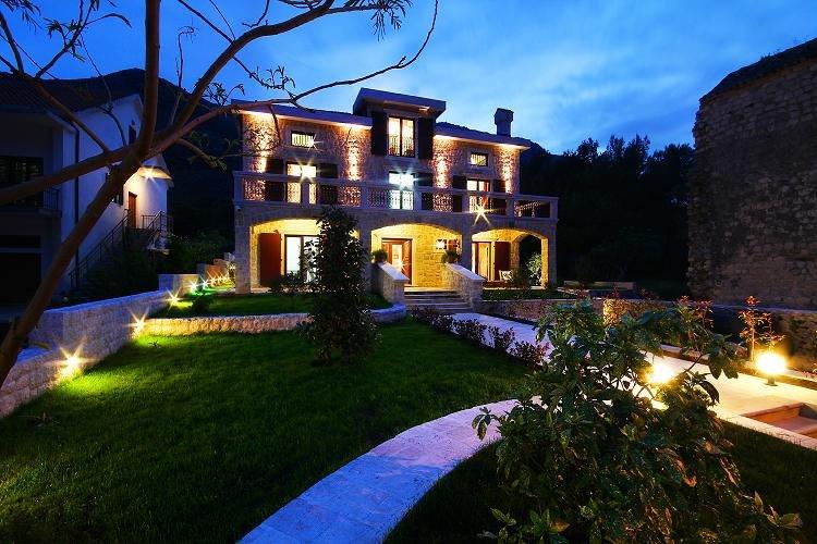 In front of villa at night