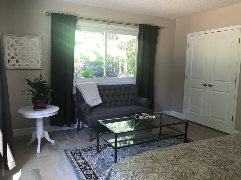 Bedroom sitting area overlooking the lawn