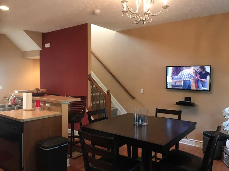 Hub of the house! Cable tv that includes HBO DVR NetFlix. Kitchen/dining area combine for great room
