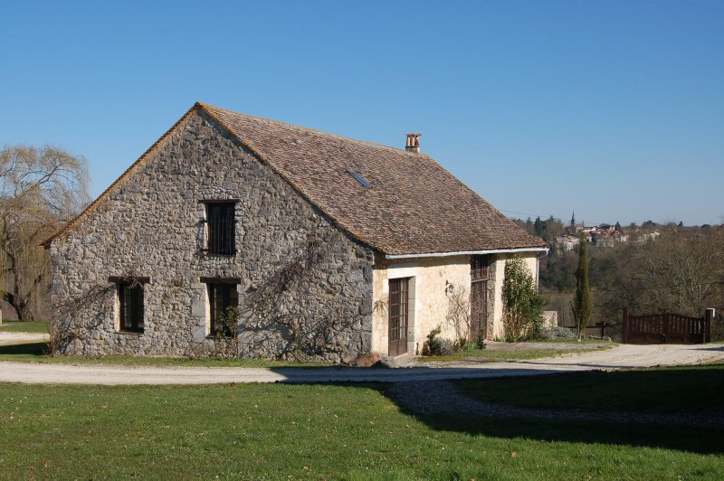 View of La Vieille Grange with St Cernin de Labarde in the background
