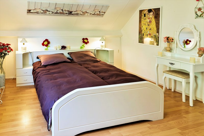 Romantic double bed and dressing table in the master bedroom