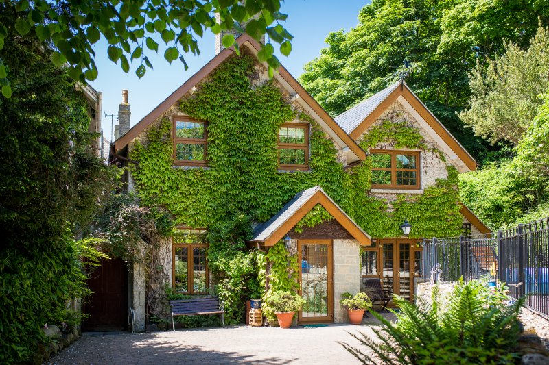 Ivy covered cottage built in 1862, extended and improved to provide a modern, comfortable space.