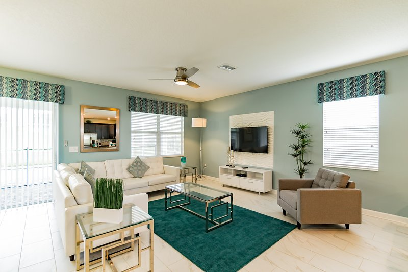 greenish style decor living room with flat screen TV