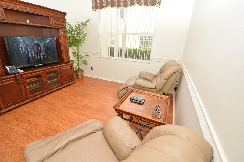 Recliner chairs in separate TV room
