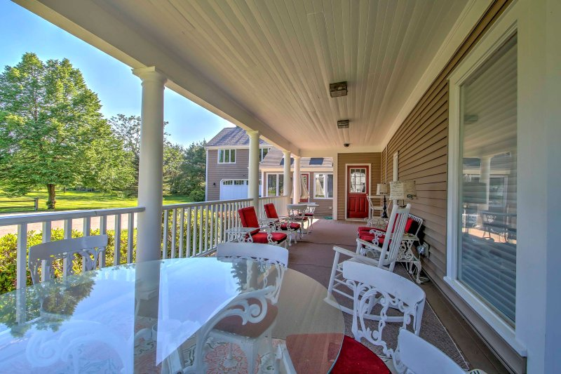 Spend your mornings sipping coffee and reading the newspaper outside on the wraparound porch.