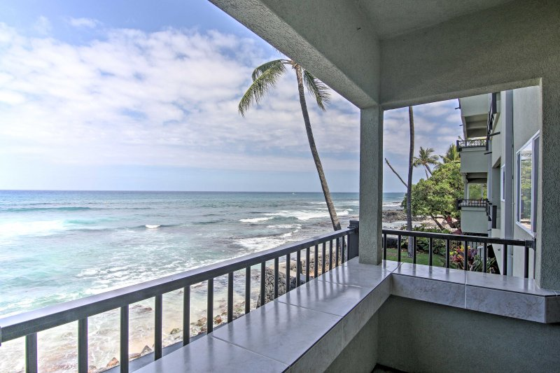 Peace and relaxation await from this Kaila-Kona condo's private balcony.