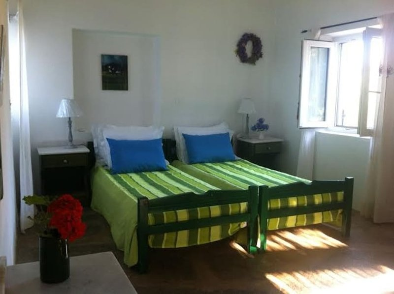 Master bedroom  set up as two twin beds. It can also be a queen bed arrangement.
