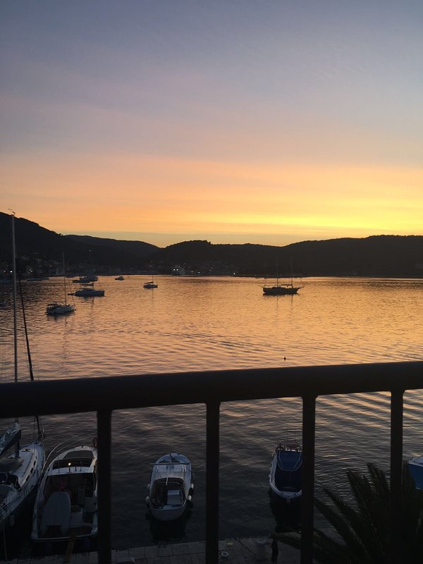 View of the harbour at sunset from the top terrace