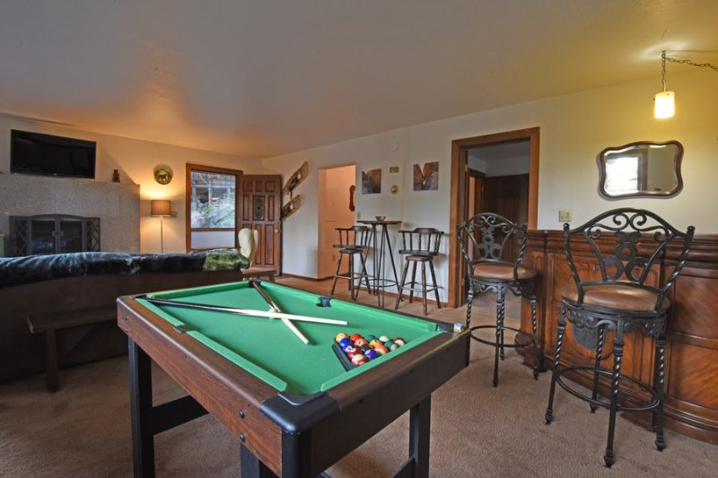 The rec room has plenty of space to entertain, plus a pool table.