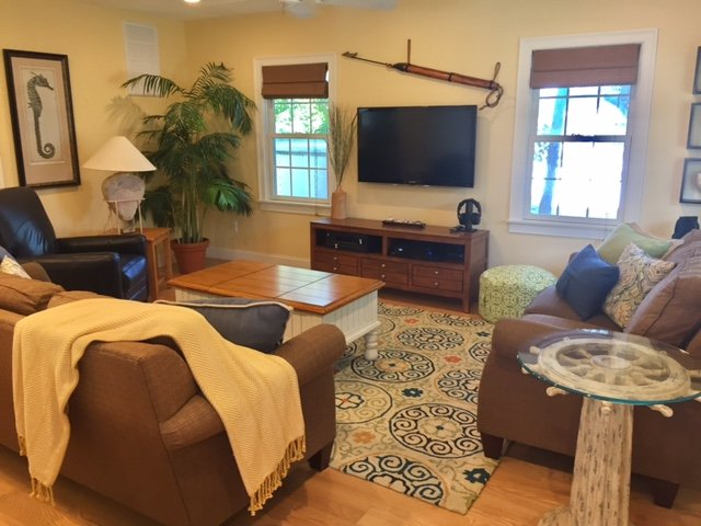 Large comfortable living room with leather recliner, sofa and loveseat. 50' TV with premium cable.