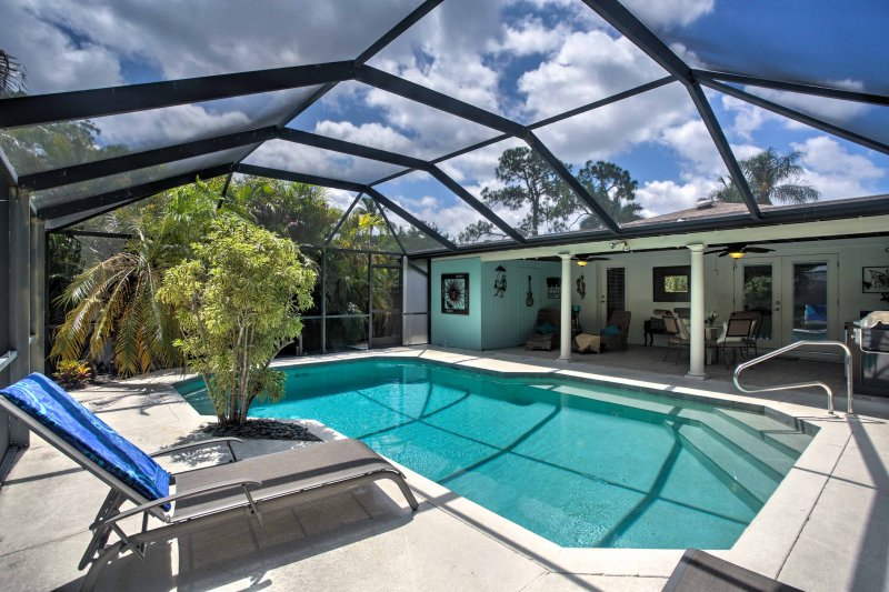 Relax in your private lanai at this Naples vacation rental bungalow!