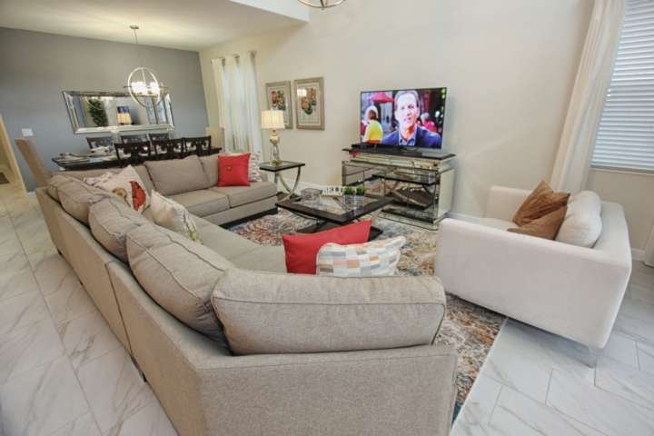 Living Area w/Modern Furniture, Flat Screen TV & Pool Access - View #2