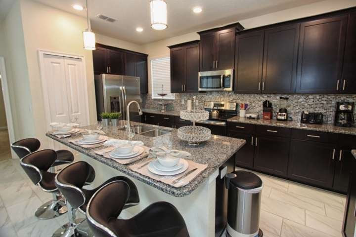 Gourmet Kitchen w/Stainless Steel Appliances & Granite Counter Tops