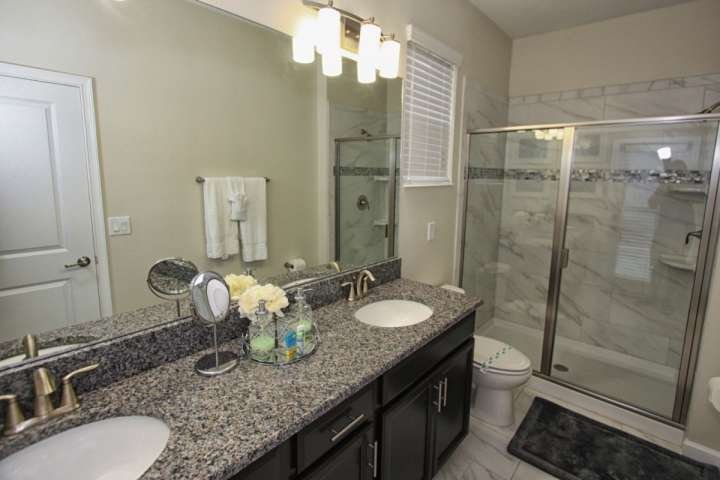 En-Suite Bath to Downstairs King Master w/Double Sinks & Walk In Shower and Pool Access Door