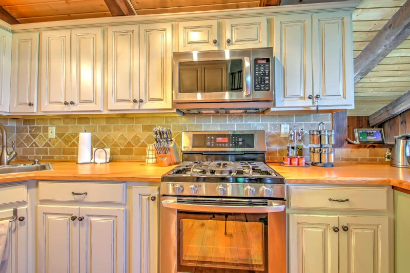 Beautifully crafted cabinets and wooden counter tops add character to the space.