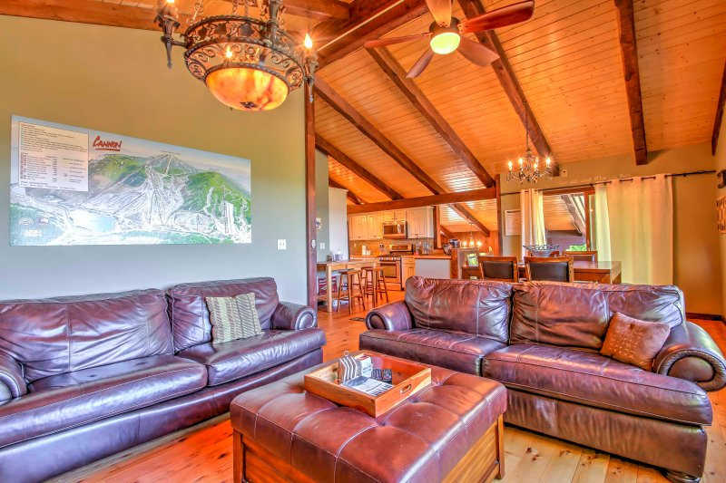 The cozy living room is warm and inviting with 2 large leather sofas.