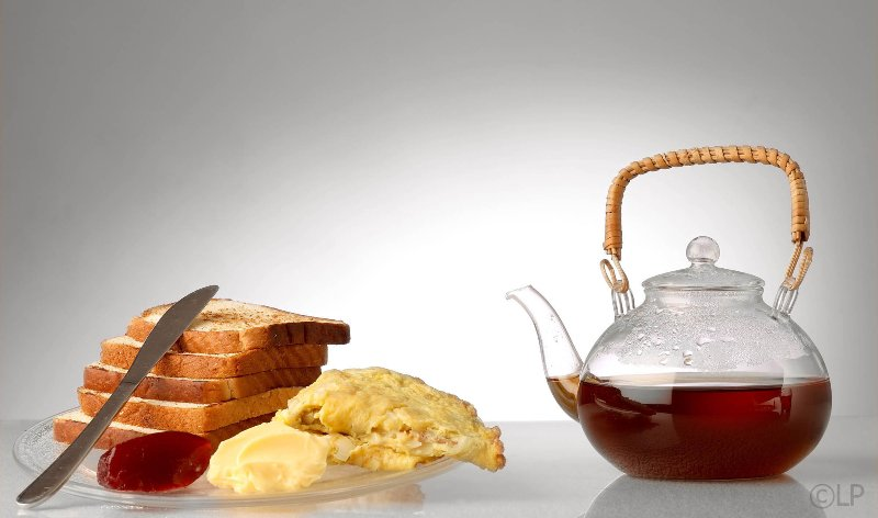 Bread, Toast,Jam,Butter,Omlet & Black Tea