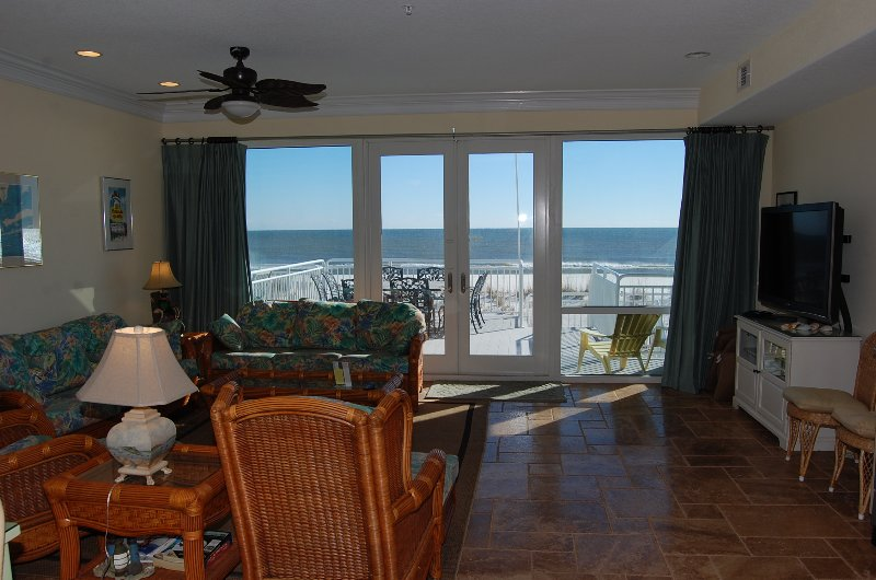 Living room w/view of the Gulf of Mexico and access to main deck which features beach access