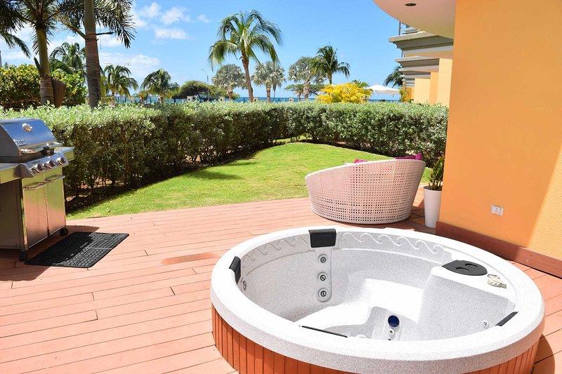 BEACHFRONT - EAGLE BEACH - OCEANIA RESORT - Beach Garden 1BR condo - E124-2, vacation rental in Aruba