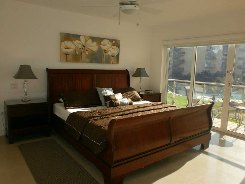 Luxurious master bedroom with king-size bed and balcony