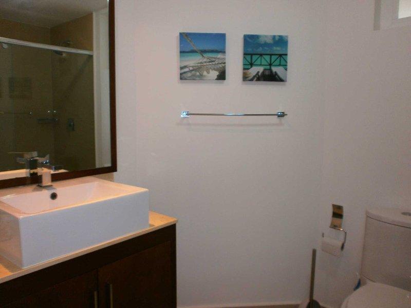 A third full modern bathroom with shower