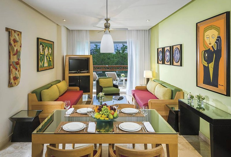 .Living room, dining and kitchen behind dining area
