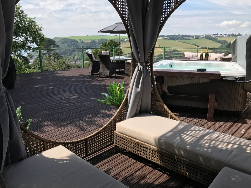 Stunning elevated deck with sea and countryside views, hot tub, sun loungers, cabana, BBQ & fire pit