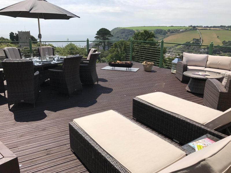 Stunning sun deck with sea & countryside views. Circular day bed, dining table with parasol seats 8