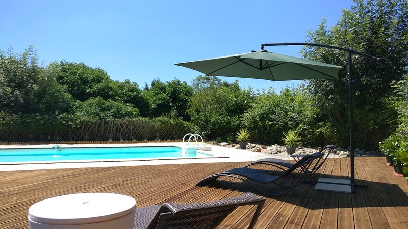 Secluded pool area across the decking. We have a large 10mx5m pool with patio.
