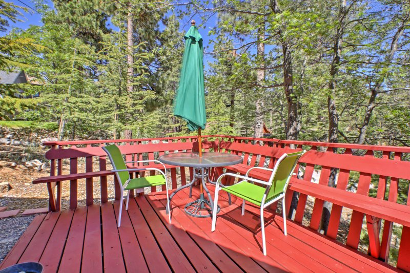 This charming property boasts a spacious deck with tranquil forest views.