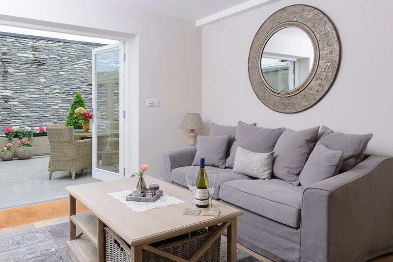 Luxuriously appointed living room opening out through French Doors to your private patio