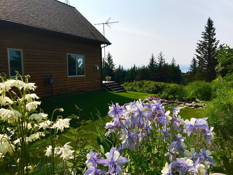 Flower gardens surround Cozy Cove Inn.