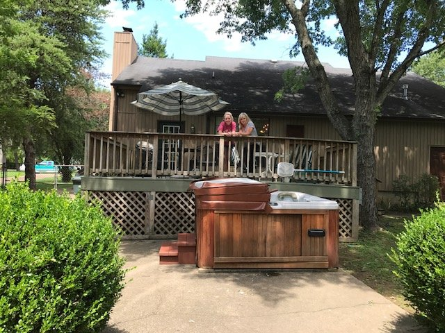 Large back deck with hot tub
