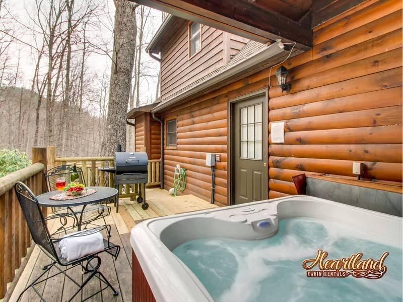Enjoy a family BBQ on back deck of Bear Tootin cabin rental