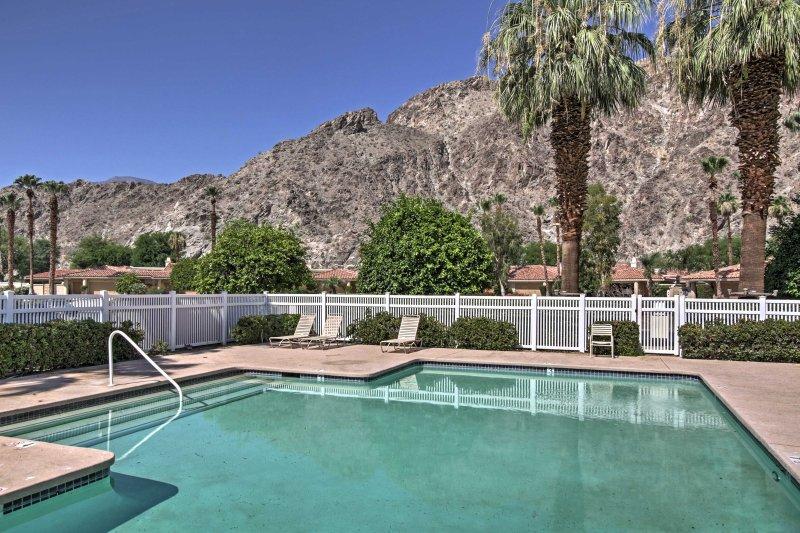 This 3-bedroom, 3.5-bath vacation rental in La Quinta is near a community pool.