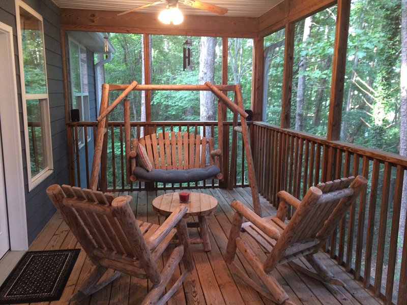 Rustic porch overlooking woods and cove