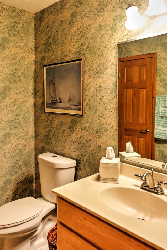 The downstairs powder room offers convenience.