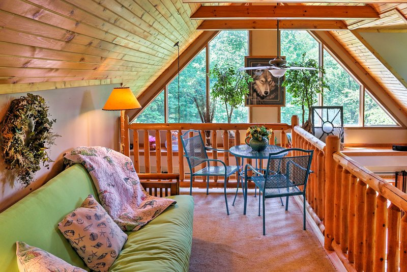The loft area offers additional sleeping with a queen-sized futon.