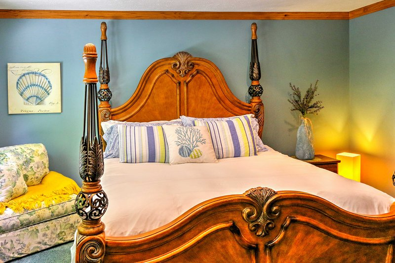 Stretch out on the king-sized bed in the master bedroom with a flat-screen satellite TV.