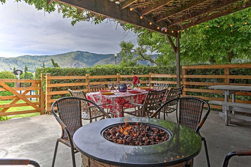 The property features a large covered patio with a fire pit and mountain views!