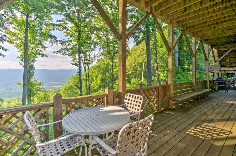 Watch the sun rise over the trees from your private balcony!
