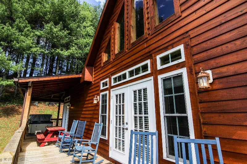 Deck with hot tub and rocking chairs