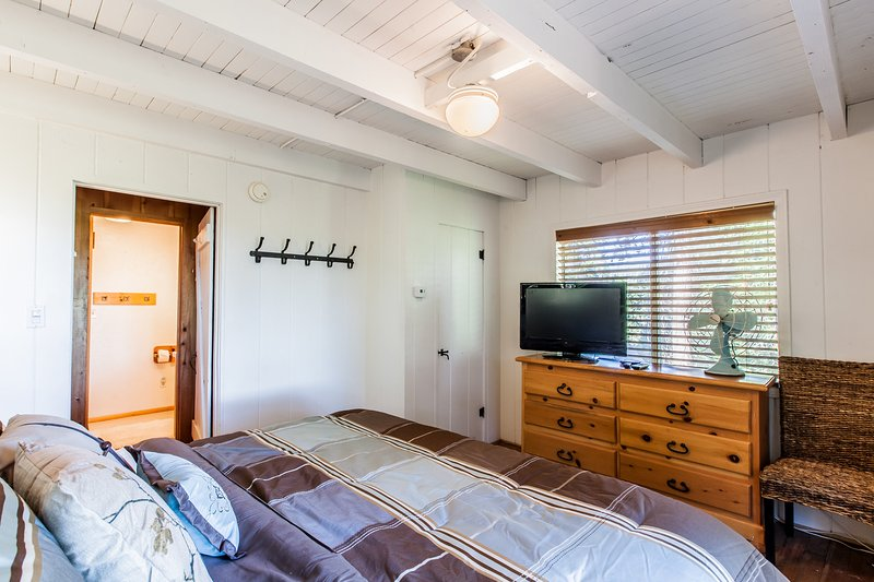 Master bedroom with Cal-king bed and flat screen TV