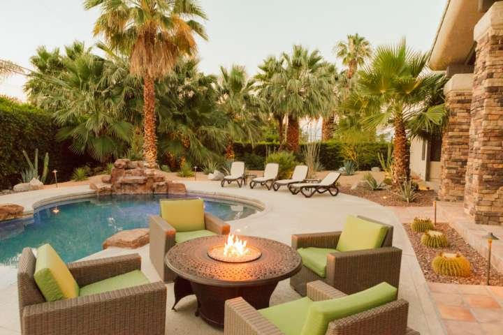 Enjoy the great views and backyard from the poolside fire table, turn on the misting system to stay cool in the sun