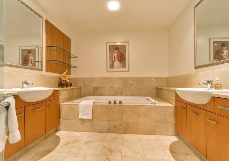 Luxury marble ensuite with separate bath and shower.