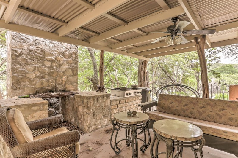 This house offers an expansive outdoor living area overlooking Johnson Creek.