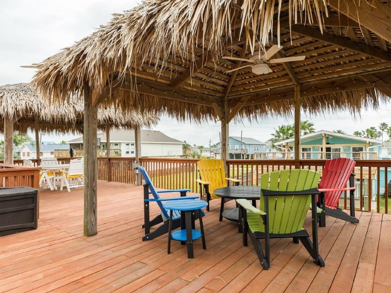 Relax in the shade under the palapa huts.